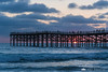 Sun dipping into the Pacific behind Crystal Pier in San Diego