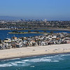 Aerial view of Mission Beach with the San Diego skyline in the distance.