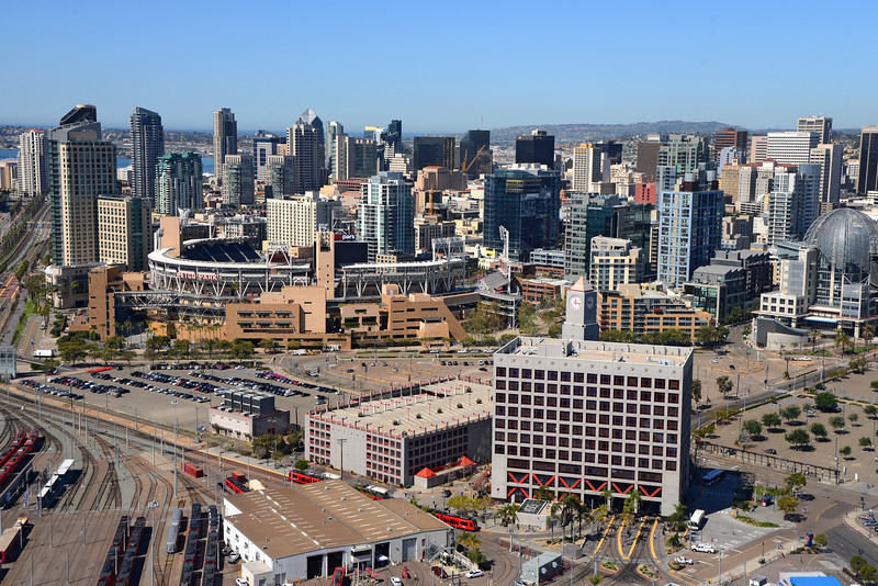 Aerial view of San Diego downtown from the south, with the trolley building in the foreground.