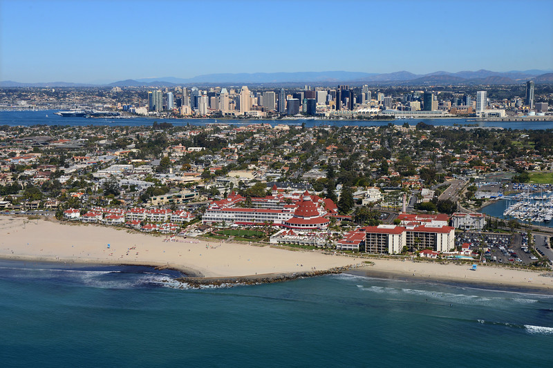 Aerial View of the Hotel Del Coronado with the San Diego skyline in the background.