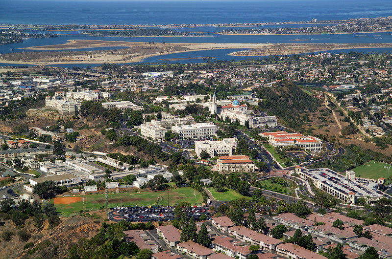 Aerial view of the University of San Diego campus, perched on a bluff overlooking Mission Bay and the Pacific Ocean.