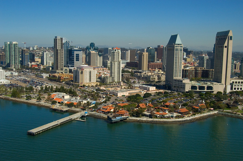 Aerial view of the harbor and Seaport Village with downtown San Diego in the background.