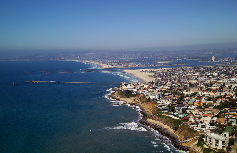 Aerial view looking north from Sunset Cliffs to Ocean Beach, with Pacific Beach and Mission Bay in the background.