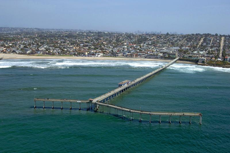 Aerial view of the Ocean Beach Pier and beach in  San Diego