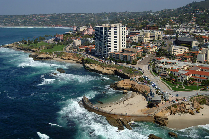 Aerial photo of the La Jolla Children's Pool and beautiful shoreline, with the village of La Jolla.