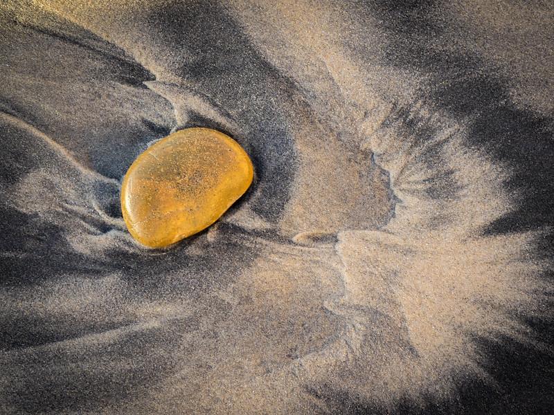 Rocks direct sand flow
