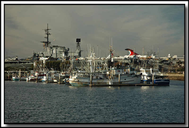 San Diego Harbor, fishing fleet with the carrier Midway in the background