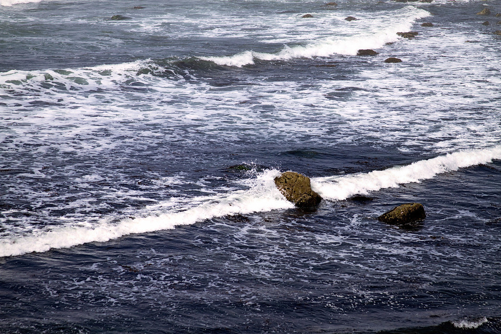 the ocean crashing upon the rocks