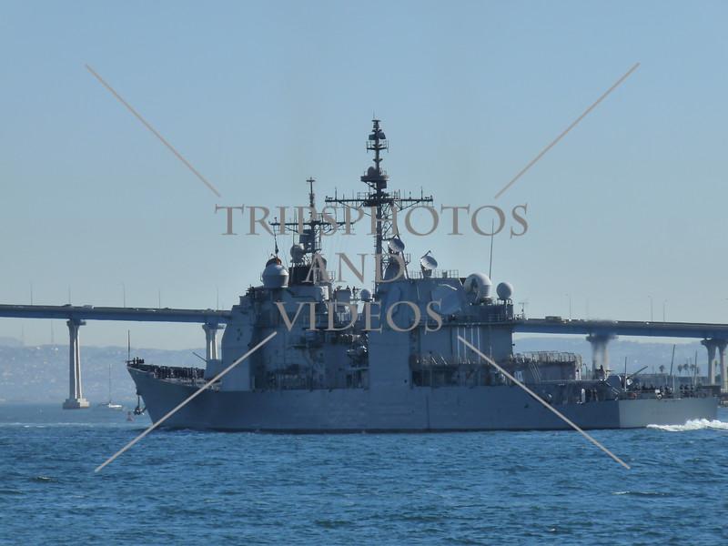 A US Navy ship sailing the San Diego Bay near the Embarcadero Marina Park in San Diego, California.