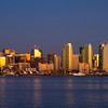 San Diego skyline at dusk as seen from Harbor Island on San Diego Bay.