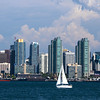 San Diego bay and skyline with sailboat.
