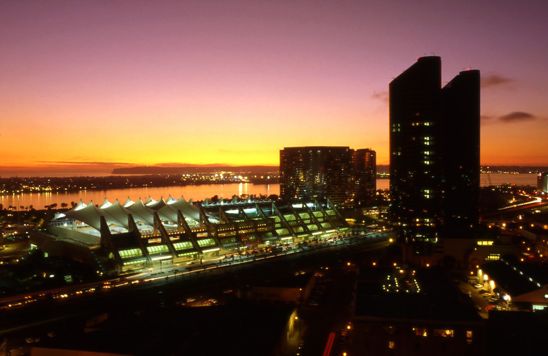 San Diego Convention Center at dusk with a vivid sunset.