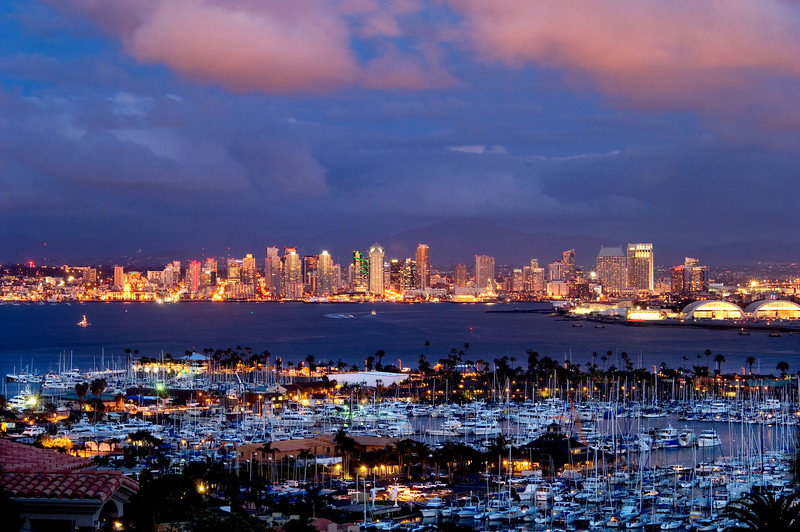 San Diego skyline and bay lit up at dusk.