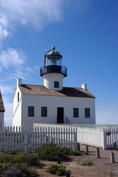 The Old Point Loma Lighthouse, high on a hill overlooking the Pacific Ocean, at the Cabrillo National Monument in San Diego, California.