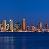 Scenic night time San Diego skyline panorama with views from the County Building to the Coronado Bridge.
