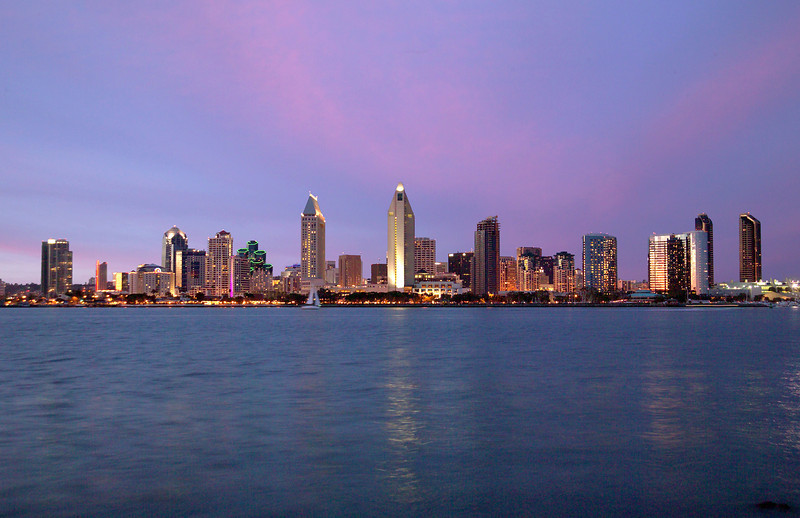 View of San Diego skyline at dusk from across the bay on Coronado Island.