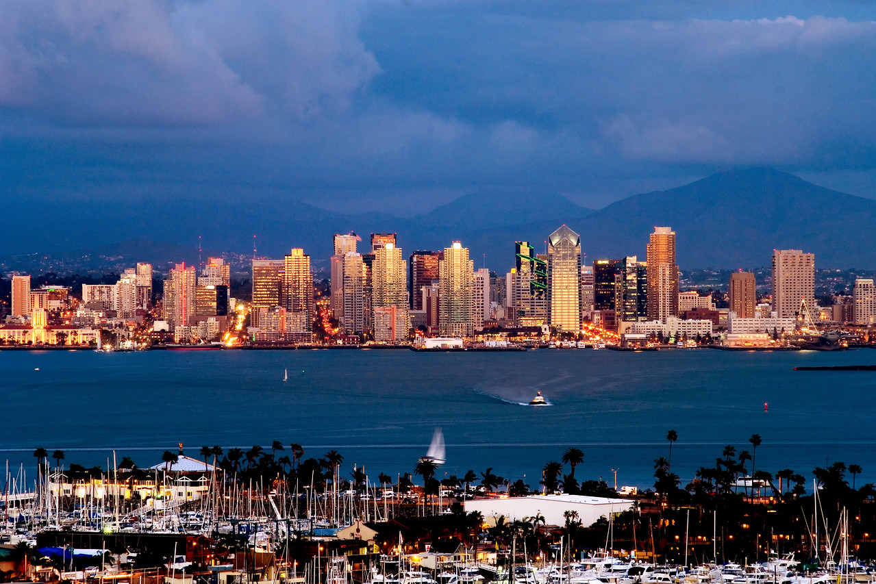 San Diego skyline lit up by the setting sun, in this view from Point Loma.