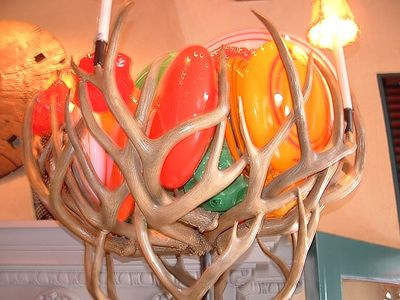 Torcheire made of sculpted glass and antlers inside the Prado restaurant, Balboa Park, 27 Jun 2004