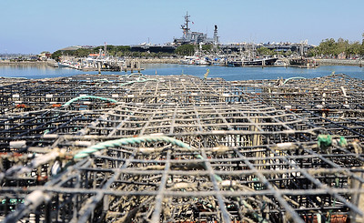 USS Midway over the top of a bunch of lobster traps.