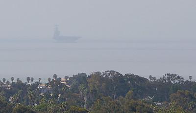 USS Nimitz on the horizon.