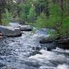 Rock Creek rushes down between the boulders in the Eastern Sierra of California.