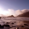 The fog rolls in late in the afternoon on the beach in Big Sur.