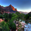Sunset view of the Watchman  from the Canyon Bridge, over the Virgin River, in Zion National Park.