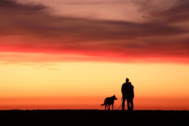 Enjoying a California coastal sunset with man's best friend.