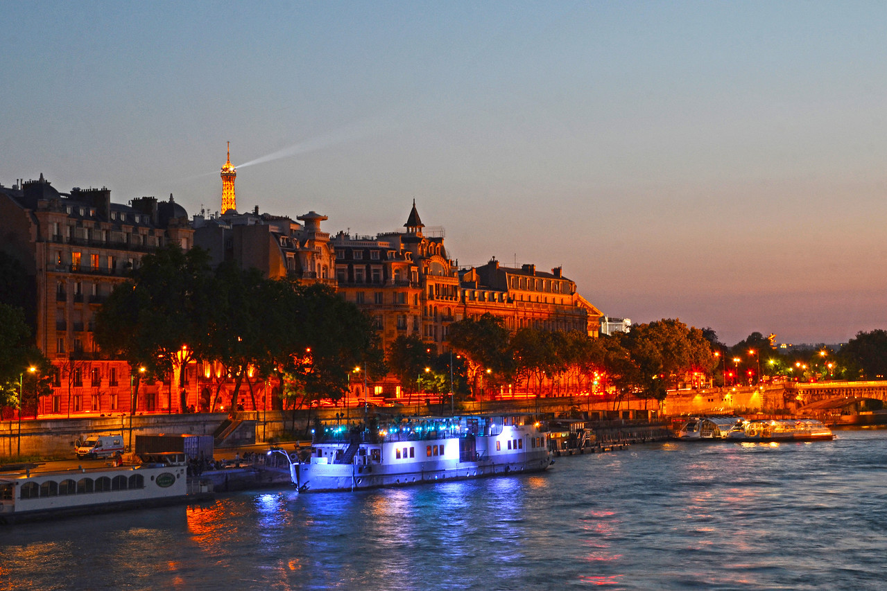 The Seine River lit up at night in Paris