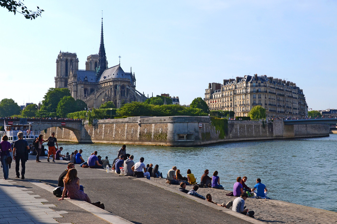 Sitting by the Seine near Notre Dame on a sunny afteroon