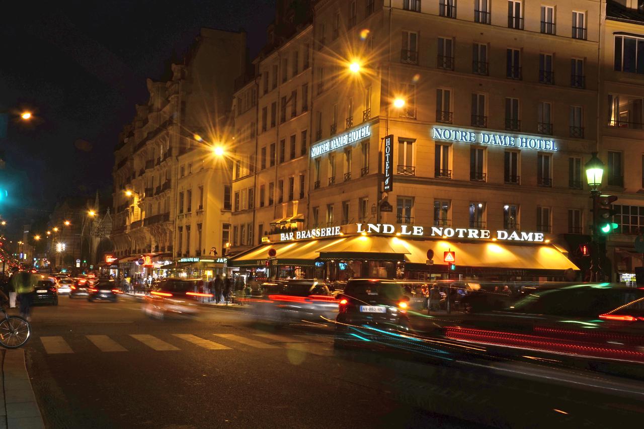 Night street scene at the Notre Dame Hotel, Paris
