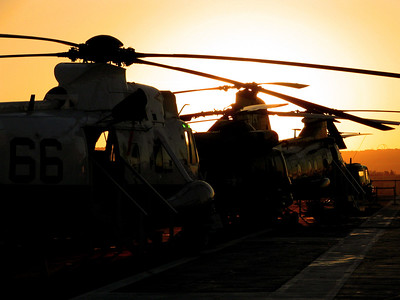 Helos on the USS Midway at Sunset