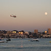 Full moon and a copter over San Diego's marina.
