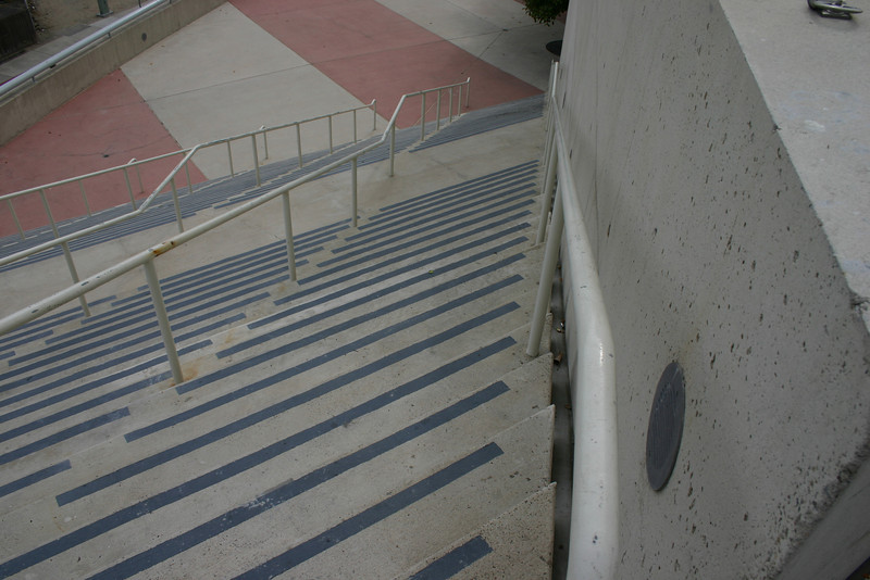 "Stairway To Insanity It might take a while with a photograph, but I\'m convinced that anyone who walks down these stairs in real life -- near the convention center in San Diego, CA -- is sure to develop a headache.The stairs themselves slant, so one is torn between walking straight (and running into the rail), or following the rail (and crab-walking).They\'re ""crazy stairs\"""