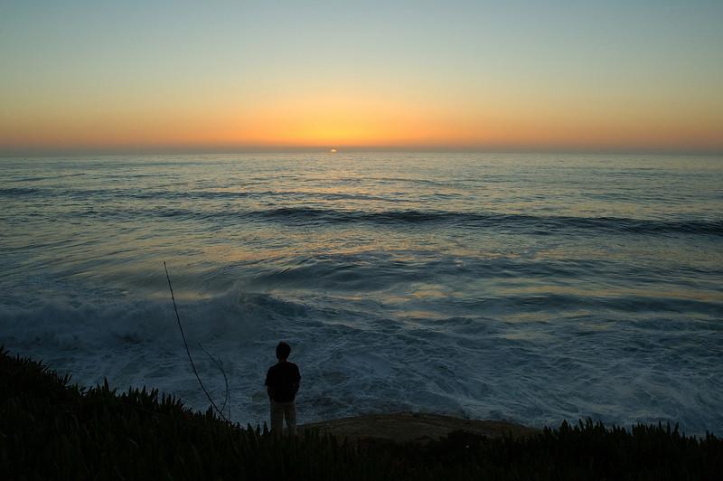 La Jolla: A contemplative look into the setting sun over the Pacific.
