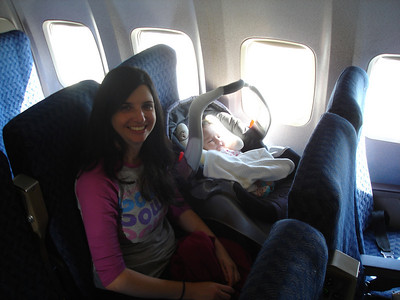 Baby's first window seat!   Scarlet was an absolute dream to fly with.  She slept through most of both flights, made no noise at all, and had the stewardesses eating out of her hand.