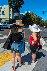Women Tourists with Large Sun Hats,