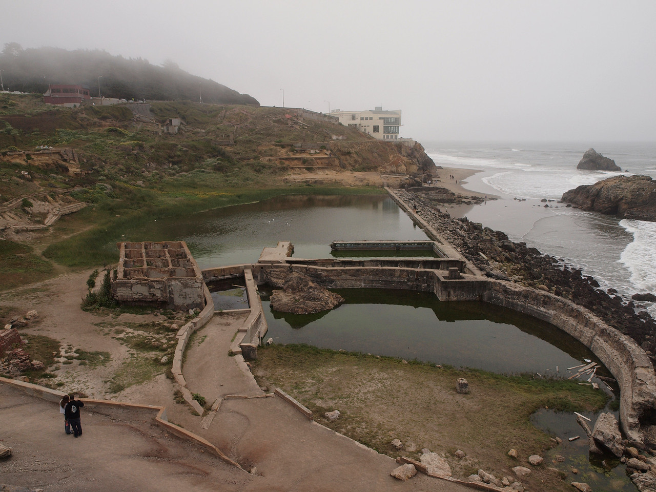 """Building in the upper-right is the wonderful Cliff House restaurant. The ruins in the forground are what is left of what was the Sutro Baths..<br /> <br />  <a href=""""http://en.wikipedia.org/wiki/Sutro_Baths"""">http://en.wikipedia.org/wiki/Sutro_Baths</a>"""