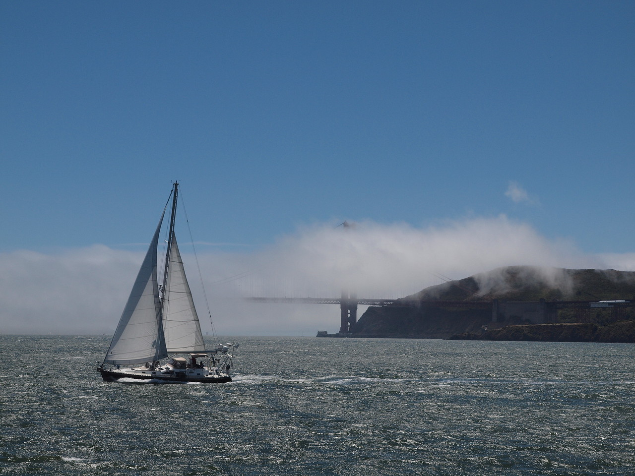 Sail boat and Golden Gate Bridge in the fog.
