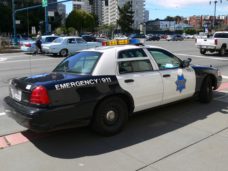 San Francisco's finest... illegally parked on the curb.