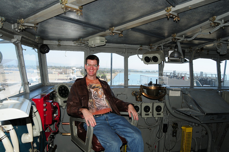 On board the USS Hornet Aircraft Carrier.  I'm sitting in the captian's chair.