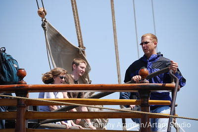 visitors shanghaied into manning the foredeck capstan