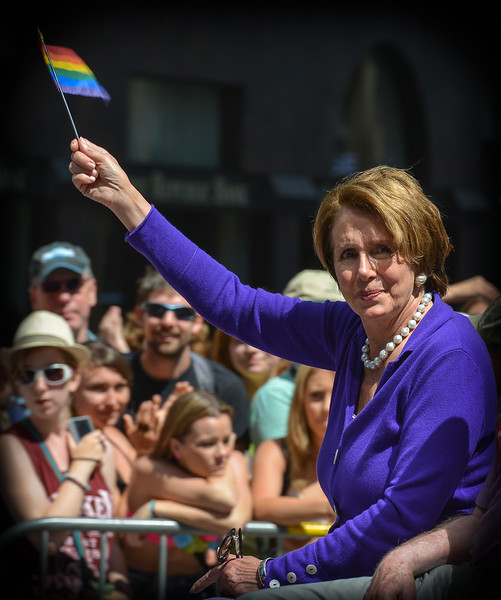 Nancy Pelosi shows her strong support at the 2013 San Francisco Gay Pride Parade!!   Nancy Pelosi, the consummate politician, finds the largest lens among the 1 million parade watchers which, in this case, happens to be mine... and she smiles for the camera!  JCH 4281