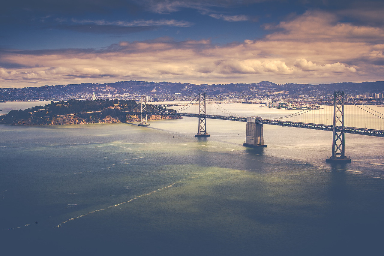 Cloudy sky above Bay Bridge and Yerba Buena Island in San Francisco