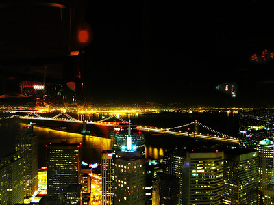 View of San Francisco and the Bay Bridge at night from the Carnellian Room at the top of the Bank of America Building