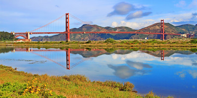 "The towers of the Golden Gate Bridge are reflected in the still waters of Crissy Field Marsh as an oil tanker heads out to sea. This image is cropped to a horizontal 15"" x 30"" format, or one of similar ratio."