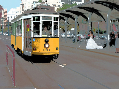 A bride and groom along the Embarcadero, San Francisco