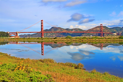 "The towers of the Golden Gate Bridge are reflected in the still waters of Crissy Field Marsh as an oil tanker heads out to sea. This is a full-framed image in the traditional digital ratio of 2:3, so it will enlarge without cropping to 20"" x 30"" or larger."