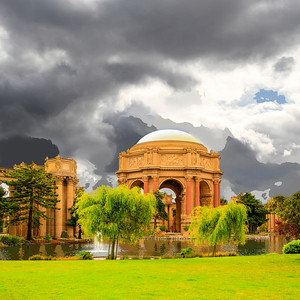 Storm clouds brood over the Palace of Fine Arts in the Marina District of San Francisco, a monumental structure originally constructed for the 1915 Panama-Pacific Exposition in order to exhibit works of art. One of only a few surviving structures from the Exposition, it is the only one still situated on its original site. It was rebuilt in 1965, and renovation of the lagoon, walkways, and a seismic retrofit were completed in early 2009. The Palace of Fine Arts was designed by Bernard Maybeck, who took his inspiration from Roman and Greek architecture in designing what was essentially a fictional ruin from another time.