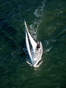 Sailboat passing under the Golden Gate Bridge